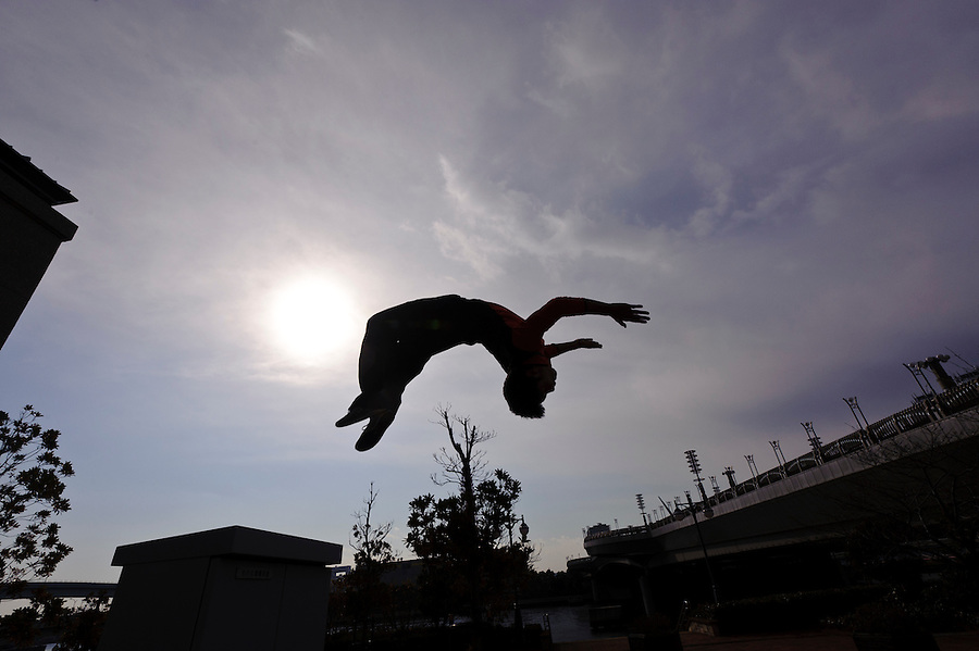 "Traceur (Parkour practitioner) Jun ""Sullivan"" Sato executes a back flip. Practicing Parkour in Odaiba, Tokyo, Japan, January 27, 2012. Parkour is a modern method of physical training, also known as freerunning. It was founded in France in the 1990s. There is a small group of around 50 parkour practitioners in Tokyo."