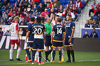 HARRISON, NJ - Sunday April 26, 2015: Omar Gonzalez receives a yellow card in the second half of play.  The New York Red Bulls tie the Los Angeles Galaxy 1-1 at home at Red Bull Arena in regular season MLS play.