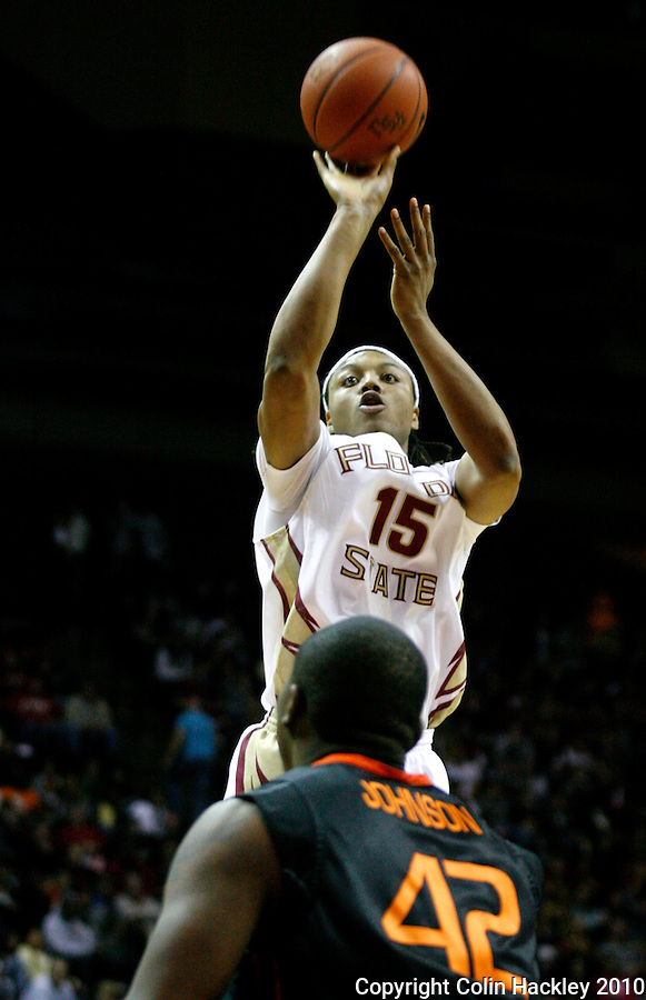 TALLAHASSEE, FL 2/6/10-FSU-MIAMI BB10 CH06-Florida State's Terrance Shannon shoots over Miami's Reggie Johnson during first half action Saturday at the Donald L. Tucker Center in Tallahassee...COLIN HACKLEY PHOTO