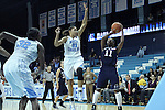 11 November 2012: Duquesne's Ahjah Hall (11) is defended by North Carolina's Krista Gross (21) and Waltiea Rolle (32). The University of North Carolina Tar Heels played the Duquesne University Dukes at Carmichael Arena in Chapel Hill, North Carolina in an NCAA Division I Women's Basketball game, and a quarterfinal in the Preseason WNIT. UNC won the game 62-58