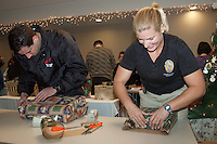 SMPD Police Activities League (P.A.L) Officers Jennifer Rodriguez and Austin Brown wrap gifts  during the  'Its a Wrap Party' at Santa Monica Place on Thursday, December 15, 2011.  The toys will be distributed this Saturday at Santa Monica PAL's Holiday Workshop.