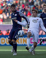 New England Revolution defender Franco Coria (2) and DC United forward Josh Wolff (16) battle for the ball. In a Major League Soccer (MLS) match, the New England Revolution defeated DC United, 2-1, at Gillette Stadium on March 26, 2011.