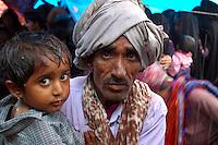 Father and son getting drenched at a Maldhari wedding..Michael Benanav - mbenanav@gmail.com