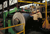 Men operating machinery at steel fabrication plant. Birmingham Alabama, Copperweld.