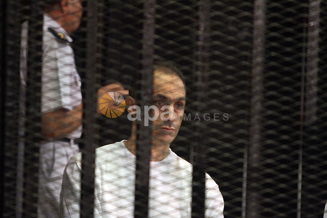 CAIRO, July 9, 2012  Gamal Mubarak, a son of former Egyptian president Hosni Mubarak, is seen behind bars during a trial at the police academy in Cairo, July 9, 2012. Egypt's South Cairo Court on Monday started the trial of Mubarak's sons Gamal and Alaa over stock manipulation. (Credit Image: © Ahgomm/Xinhua/ZUMAPRESS.com)