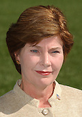 Washington, DC - September 16, 2001 -- First Lady Laura Bush listens to United States President George W. Bush's remarks as they returned to the White House from Camp David on Sunday, September 16, 2001..Credit: Ron Sachs / CNP