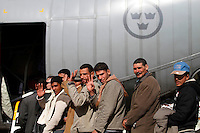 Egyptian refugees board a Swedish Air Force C-130 transport aircraft to for return to Egypt.  Tens of thousands of people, mainly migrant workers, fled unrest in Libya and crossed the border into Tunisia. Some slept in the open for several days before being processed.  At the same time forces loyal to Col. Gaddafi fought opposition forces in various parts of the country.