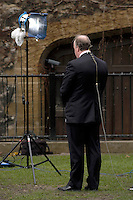 UK. London. From a story on Abingdon Street Gardens, a small patch of land, often referred to as College Green, that lies next to The Houses of Parliament in Westminster. It is a place where the media and the politicians come face to face. Interviews are held, photo shoots are set up and bewildered tourists stroll by..Photo shows TV reporter waiting to film..Photo©Steve Forrest/Workers Photos