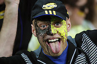 A Hurricanes fan celebrates Ma'a Nonu's try during the Super 14 rugby match between the Hurricanes and Crusaders at Westpac Stadium, Wellington, New Zealand on Friday, 2 April 2010. Photo: Dave Lintott / lintottphoto.co.nz