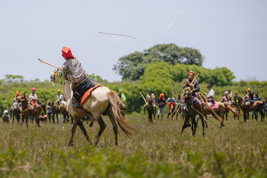 A Pasola warrior throws the spear at the enemy forces during the event in Homba Kalayo, Kodi. Pasola is an ancient tradition from the Indonesian island of Sumba. Categorized as both extreme traditional sport and ritual, Pasola is an annual mock horse warfare performed in response to the harvesting season. In the battelfield, the Pasola warriors use blunt spears as their weapon. However, fatal accident still do occurs.