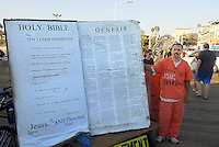 Christian Street Preacher Isidro Mendoza proselytizes at the Santa Monica Pier on Sunday, Aug 19, 2012..