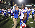 Louisiana Tech defensive line coach Stan Eggen (left) and Jon'al White (95) celebrate a win over Ole Miss in Oxford, Miss. on Saturday, November 12, 2011. Louisiana Tech won 27-7.