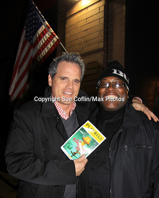 """As The World Turns' Michael Park poses with Dallis who is security (at Lucky Strike) as Michael comes to see Joe West starring in """"A Christmas Story The Musical"""" on opening night after party at Lucky Strike on November 19, 2012 at the Lunt-Fontaine Theatre, New York City, New York where the musical is. (Photo by Sue Coflin/Max Photos)"""