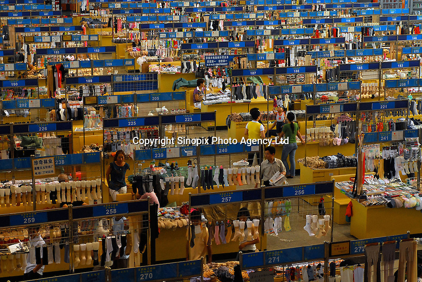 "The sock trading market at ""Datang Sock Town"" in Zhuji City, Zhejiang Province, China. Most factories have a presence at this market and traders are able to come here and make orders of ten or a million pairs at a time. The town in Zhejiang Province makes more than 5.3 billion pairs of socks annually - that 2.5 pairs for every human alive. Most people in the town make a living directly connected to the sock weaving industry..14 Jun 2006."