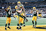 Green Bay Packers' Greg Jennings and Green Bay Packers' Scott Wells celebrate Jennings touchdown catch in the 2nd quarter.The Green Bay Packers played the Pittsburgh Steelers in Super Bowl XLV,  Sunday February 6, 2011 in Cowboys Stadium. Steve Apps-State Journal.