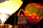 A woman takes photos of glowing hot air balloons following a dinner at the Sun City Country Club in honor of the 50th anniversary of Sun City December 9, 2010...2010 marks the 50th anniversary of Sun City, America's first retirement city that remains the largest today with more than 40,000 residents 55 and older.