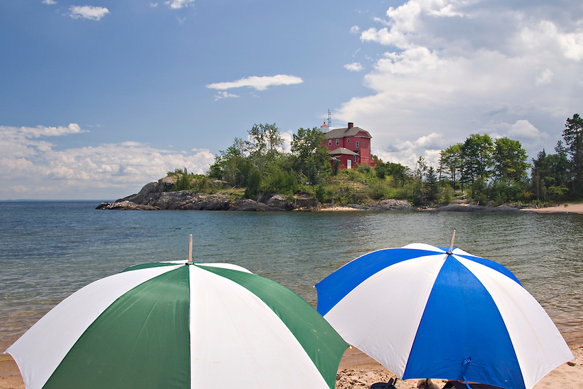 Colorful umrellas at the McCarty Cove beach on Lake Superior near the Marquette Lighthouse in Marquette Michigan.