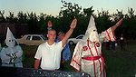 "Modesto -- Bill Albers, the grand wizard of the American Klan in Modesto, spoke to the audience, shouting ""white power!"" at the end of his speech.  Two other speakers were Jim Cheney of the Federation of the Klans and Paul Nolff from the Aryan Nation.  Both came from Fresno.  That evening the groups gathered at Albers' home north of Modesto where a cross was burned.  June 10, 1995   Photo by AL GOLUB / Golub Photography"