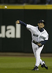 Seattle Mariners' right fielder Ichiro Suzuki  throws a ball hit by Texas Rangers'  Michael Young in the first inning in Seattle, Washington on Tuesday, 27 September, 2005. Jim Bryant Photo. ©2010. ALL RIGHTS RESERVED.