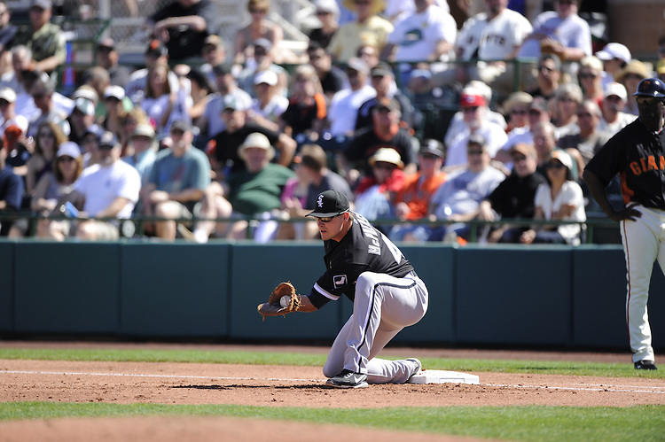 SCOTTSDALE, AZ - MARCH 09:  Dallas McPherson #45 of the Chicago White Sox fields during the game against the San Francisco Giants on March 09, 2011 at Scottsdale Stadium in Scottsdale, Arizona. The Giants defeated the White Sox 4-2.  (Photo by Ron Vesely)