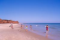 Ile du Havre-aux-Maisons, Iles de la Madeleine, Quebec, Canada - Children playing on Beach at Dune du Sud along Gulf of St. Lawrence - (South Dune, House Harbour Island, Magdalen Islands)
