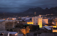 Rooftops of the medina or old town of Tetouan in the evening, on the slopes of Jbel Dersa in the Rif Mountains of Northern Morocco. Tetouan was of particular importance in the Islamic period from the 8th century, when it served as the main point of contact between Morocco and Andalusia. After the Reconquest, the town was rebuilt by Andalusian refugees who had been expelled by the Spanish. The medina of Tetouan dates to the 16th century and was declared a UNESCO World Heritage Site in 1997. Picture by Manuel Cohen