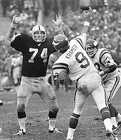 Raider Dave Rowe and Minnesota Vikings QB Tom Kramer..(1977 photo/Ron Riesterer)