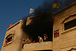 "Settler fortify as they are evacuated by police from an abandoned Palestinian building, which they took-over in the Israeli settlement bloc of Gush Katif, Gaza Strip. In a defiant act against Israel's upcoming pullout from Gaza, settlers took over the house, which is located in the Arab area of Muwasi, and renamed it to ""Tal Yam"" outpost."