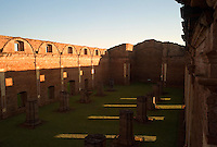 Evening light spills through sanctuary windows at the ruins if the Jesuit mission church at Jesus de Tavarangue, Paraguay. Scores of Jesuit missions in the area where Paraguay, Argentina and Brazil meet were built in the 17th century and abandoned when the Jesuits were expelled in the 18th century. Ruins of some of these missions still haunt hilltops in the region. (Kevin Moloney for the New York Times)