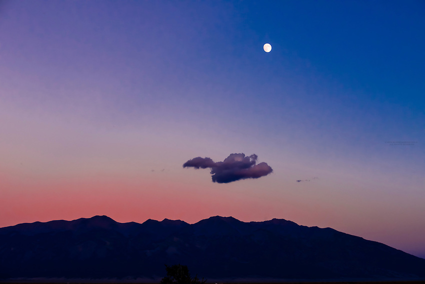 Moon rise over the Sangre de Cristos Mountains, near Alamosa, Colorado USA.