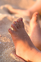 Girls feet with sand on them
