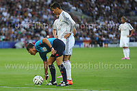 Cardiff City Stadium, Cardiff, South Wales - Tuesday 12th Aug 2014 - UEFA Super Cup Final - Real Madrid v Sevilla - <br /> <br /> Real Madrid&rsquo;s Christiano Ronaldo looks on as Referee Mark Clattenburg marks out the line. <br /> <br /> <br /> <br /> <br /> Photo by Jeff Thomas/Jeff Thomas Photography