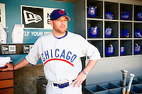4 May 2011: Cubs bullpen catcher Andy Lane poses in the dugout before the game to show off the throw back uniforms. The Cubs defeated the Dodgers 5-1 during a Major League Baseball game at Dodger Stadium in Los Angeles, California.  Dodgers players are wearing Brooklyn Dodger 1940's throwback jersey uniforms and the Chicago Cubs are also wearing throwback retro jersey uniforms. **Editorial Use Only**