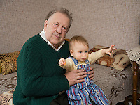 Happy Caucasian Elderly Senior Grandfather Holding Kid Baby