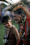 """Ethnic Pride Native American, grandfather and grandson dressed in regalia at Thunderbird Pow Wow in Queens NY ..A pow-wow (also powwow or pow wow or pau wau) is a gathering of North America's Native people. The word derives from the Narragansett word powwaw, meaning """"spiritual leader""""."""