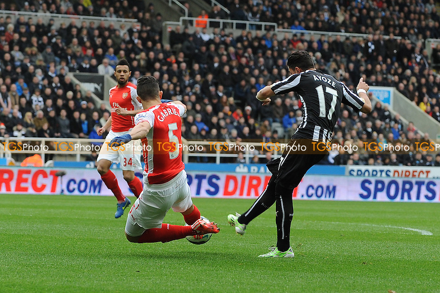 Ayoze Pérez of Newcastle United has a shot blocked by Gabriel Paulista of Arsenal - Newcastle United vs Arsenal - Barclays Premier League Football at St James Park, Newcastle upon Tyne - 21/03/15 - MANDATORY CREDIT: Steven White/TGSPHOTO - Self billing applies where appropriate - contact@tgsphoto.co.uk - NO UNPAID USE