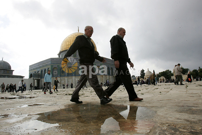 "Palestinians walk in front of the Dome of the Rock after Friday prayers at Al-Aqsa mosque compound in Jerusalem's old city on Nov. 4,2011, ahead of the Muslim Eid al-Adha festival at the end of the week. Muslims across the world are preparing to celebrate the annual ""Festival of Sacrifice"", which marks the end of the Hajj pilgrimage to Mecca and in commemoration of Prophet Abraham's readiness to sacrifice his son to show obedience to God. Photo by Mahfouz Abu Turk"