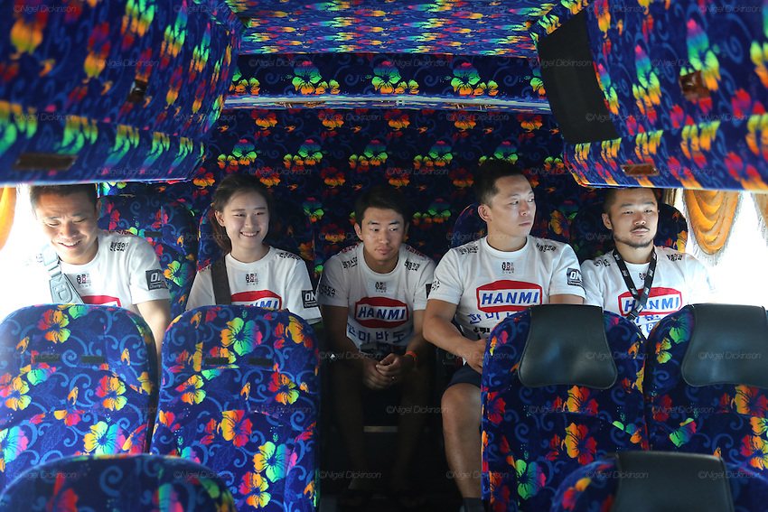 Dae Hwan Kim, Kamma Bantam weight champion, and his team in the coach on their way to the Stadium<br />