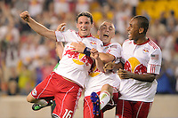 John Rooney (16) (L) of the New York Red Bulls celebrates scoring with Corey Hertzog (6) and Juan Agudelo (17) (R). The New York Red Bulls defeated FC New York 2-1 during a third round match of the 2011 Lamar Hunt US Open Cup at Red Bull Arena in Harrison, NJ, on June 28, 2011.
