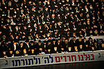 Different Haredi sects have joined forces during a general election assembly of &quot;Yahadut Hatorah&quot;, an ultra-Orthodox Jewish party running for the Israeli parliament, the Knesset. Top Haredi leaders have met to coordinate their standpoints, especially since the growing public pressure in Israeli society to recruit Haredi men to Israel's army, a move ultra-orthodox strongly oppose.<br /> The sign reads: &quot;We are all Haredim to God and his Torah&quot;.