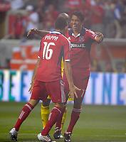Chicago midfielder Pavel Pardo (17) congratulates Marco Pappa (16) after Pappa scored an early goal to put the Fire ahead 1-0.  The Chicago Fire defeated the Columbus Crew 2-1 at Toyota Park in Bridgeview, IL on June 23, 2012.