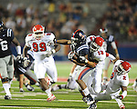 Ole Miss running back Brandon Bolden (34) is tackled by Fresno State's Derron Smith (13)  and Fresno State's Davon Dunn (2) during the fourth quarter at Vaught-Hemingway Stadium in Oxford, Miss. on Saturday, September 25, 2010. Ole Miss won 55-38.