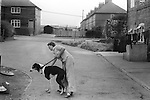 South Kirkby Colliery Yorkshire England. 1979. Northfield Estate  NCB Houses in South Kirkby. Woman and dog.
