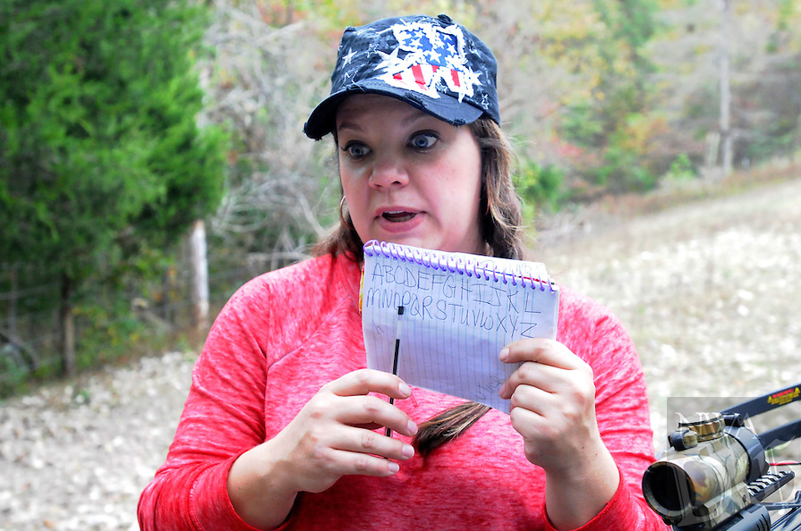 NWA Democrat-Gazette/FLIP PUTTHOFF <br /> In the field, Jackie Swope uses a pad with alphabet letters that lets      Oct. 26 2016     Steve communicate with her. Steve uses a computer at home to communicate as well.