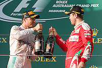 March 20, 2016: Nico Rosberg (DEU) #6 from the Mercedes AMG Petronas team and Sebastian Vettel (DEU) #5 from the Scuderia Ferrari team on the podium after Rosberg won and Vettle came third at the 2016 Australian Formula One Grand Prix at Albert Park, Melbourne, Australia. Photo Sydney Low