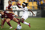 02 December 2011: Stanford's Chioma Ubogagu (9) scores the game's first goal past Florida State's Kristin Grubka (13). The Stanford University Cardinal played the Florida State University Seminoles at KSU Soccer Stadium in Kennesaw, Georgia in an NCAA Division I Women's Soccer College Cup semifinal game.