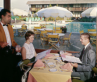 Waiter serving a young couple in the Thunderbird Motel restaurant.
