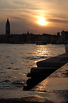 Dusk against the background of the Campanile tower and Basilica of St Marks square. Venice, Italy.
