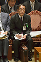 February 3, 2012, Tokyo, Japan - Ro Manabe, chief of the Defense Ministrys Okinawa Defense Bureau, takes memo before his testimony during a Diet lower house Budget Committee meeting in Tokyo on Friday, February 3, 2012. Manabe has come under suspicion of tampering with the upcoming mayoral election in Ginowan, Okinawa Prefecture, where the U.S. Marine Corps Futenma Air Station is located. Manabe might not have violated any law by reportedly holding lectureson the local elections to his subordinates, according to the media reports. Defense Minister Naoki Tanaka, however, has no other choice but to sack him to lessen the damage to the government of Prime Minister Yoshihiko Noda. (Photo by Natsuki Sakai/AFLO) AYF -mis-