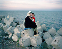 A mother and daugher sit on the artifical sea wall in Astara, near ther border with Iran. The Caspian Sea borders are still unresolved between these two countries, almost twenty years after the dissolution of the Soviet Union. Both countries claim ownership of lucrative oil fields in the southern waters, which has led to a series of confrontations, as each side has forged exploritory missions to profit from the region.